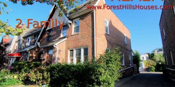 rego park semi detached brick house for sale.